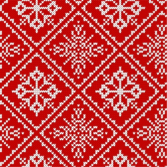 Nahtloses muster des weihnachtsstrickens mit schneeflocken.
