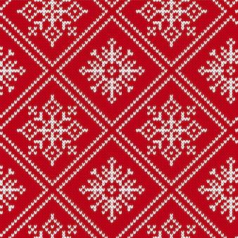 Nahtloses muster des weihnachtsstrickens mit schneeflocken