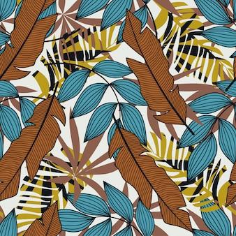 Nahtloses muster in der tropischen art mit bunten anlagen und blauen blättern. modernes design