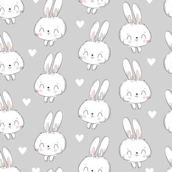 Nahtloses muster kaninchen und herz