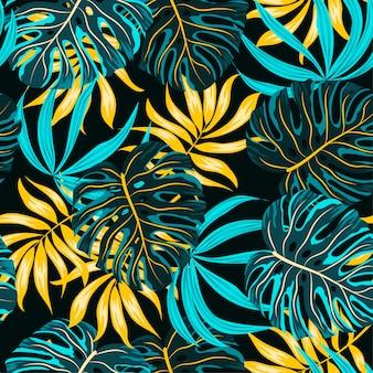 Nahtloses muster mit blauen und gelben tropischen pflanzen