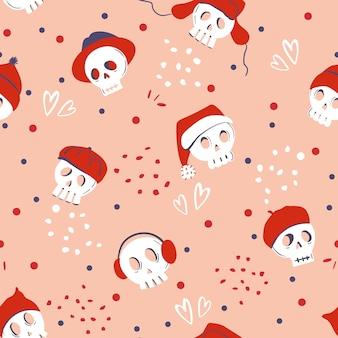 Nahtloses muster mit dem schädel, der verschiedene rote hüte auf rosa hintergrund trägt