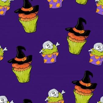 Nahtloses muster mit den schädelkleinen kuchen von halloween.
