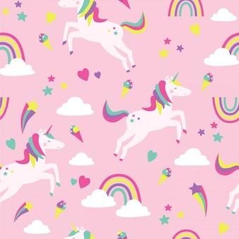 Nahtloses muster mit einhörnern, regenbogen, wolken und sternen auf rosa.