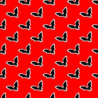 Nahtloses muster mit fledermäusen auf rotem hintergrundvektorillustrationsdesign für halloween