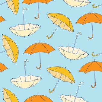 Nahtloses muster mit gelben regenschirmen