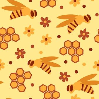 Nahtloses muster mit honigbienen in einer wabe - lustiges süßes muster im cartoon-stil auf gelb