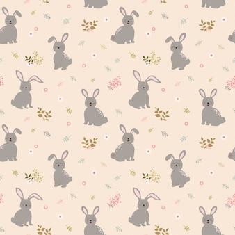 Nahtloses muster mit kaninchen die gruppe auf nettem blumenhintergrund