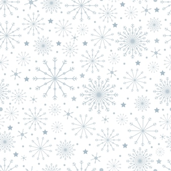 Nahtloses muster mit netten schneeflocken in den verschiedenen größen