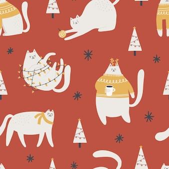 Nahtloses muster mit netten weihnachtskatzen. handgezeichnete vektorgrafik zum einwickeln, textil