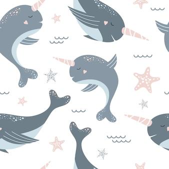 Nahtloses muster mit niedlichen blauen narwalen und starfish.