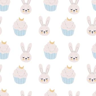 Nahtloses muster mit niedlichen kaninchen und cupcakes