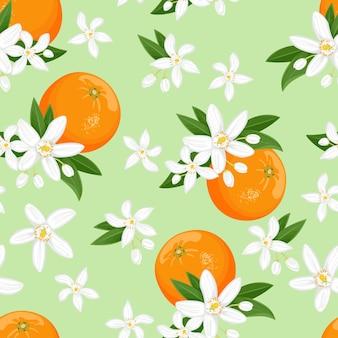 Nahtloses muster mit orangen-zitrusfrüchten und weißen blumen auf grünem hintergrund.