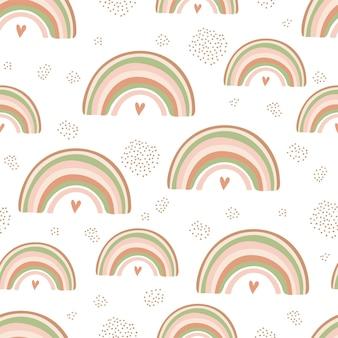 Nahtloses muster mit regenbogen und herz in pastellfarben