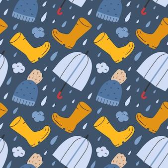 Nahtloses muster mit regenstiefeln und regenschirm