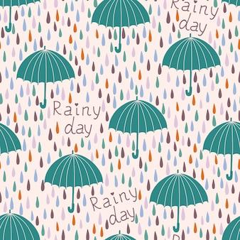 Nahtloses muster mit regentropfen und regenschirmen. frühlingshintergrund