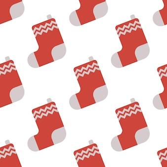 Nahtloses muster mit roter weihnachtssocke für geschenke. vektor-illustration