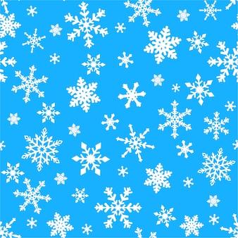 Nahtloses muster mit schneeflocken auf blau