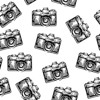 Nahtloses muster mit schwarzen kameras