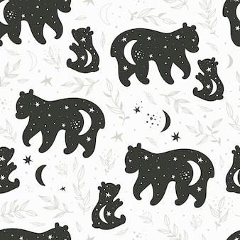 Nahtloses muster mit schwarzen und weißen silhouetten eines bären und eines teddybären
