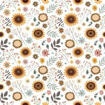 Nahtloses muster mit sonnenblumen und pflanzen