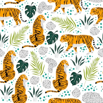 Nahtloses muster mit tigern und tropischen blättern