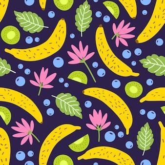 Nahtloses muster mit tropisch blühenden blumen und exotischen früchten auf schwarz