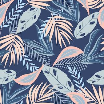 Nahtloses muster mit tropischen pastellblättern auf blau