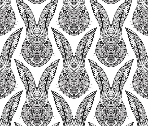 Nahtloses muster mit verziertem gekritzelhand gezeichnetem kaninchenkopf
