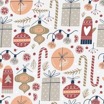 Nahtloses muster mit weihnachtselementen. für stoff, geschenkpapier und andere dekorationen.