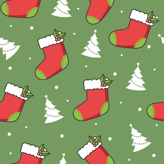 Nahtloses muster mit weihnachtssocken und -bäumen