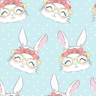 Nahtloses muster nettes kaninchen und rosa schleife. hand gezeichneter hase