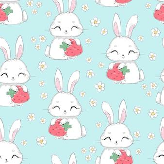 Nahtloses muster niedlicher hase mit erdbeere und blumen