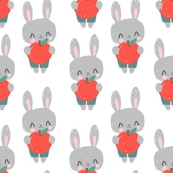 Nahtloses musterkaninchen mit apfel auf weißem illustrationsdruckdesign-textil für kindermode