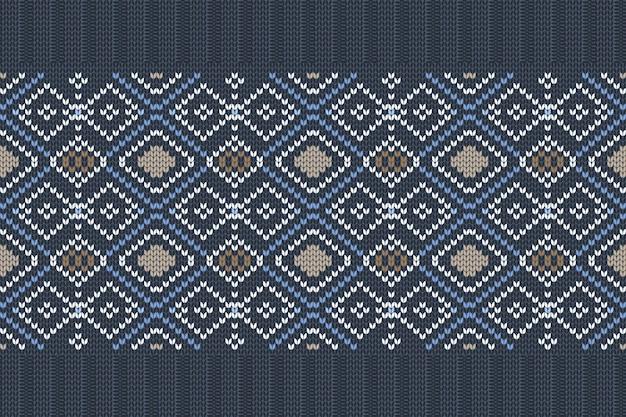Nahtloses nordisches strickmuster in den farben blau, weiß, braun mit schneeflocken.