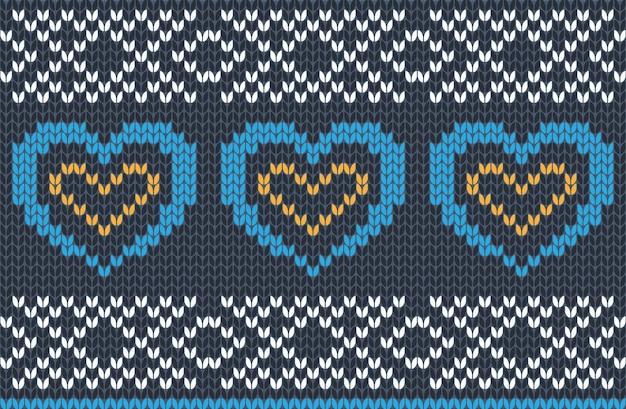 Nahtloses strickmuster in den farben blau, gelb und weiß. herbst-, weihnachts- und winterferienpullover-design mit herzen.