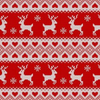 Nahtloses strickmuster mit hirschen. traditionelles skandinavisches muster für weihnachts- oder winterdesign. rote und weiße pulloververzierung.