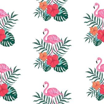 Nahtloses tropisches sommermuster mit hibiskusblüten und flamingovögeln