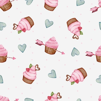 Nahtloses valentinsmuster mit herz, pfeil und cupcakes.