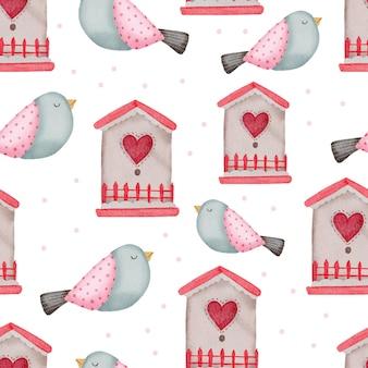 Nahtloses valentinsmuster mit vögeln und häusern.