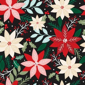 Nahtloses weihnachten mit blumen mit poinsettia und blatt auf dunkelheit
