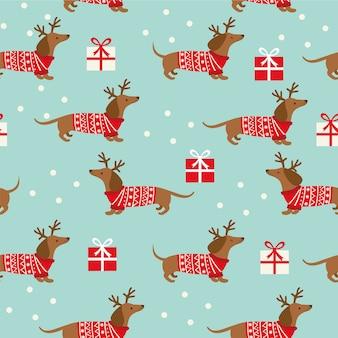 Nahtloses weihnachtsmuster mit dackel, schneeflocken und geschenken auf blau