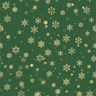 Nahtloses weihnachtsmuster mit goldschneeflocken auf grünem hintergrund. feiertag für weihnachten und neujahr dekoration.