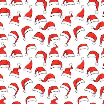 Nahtloses weihnachtsmuster mit handgezeichneten roten weihnachtsmützen.