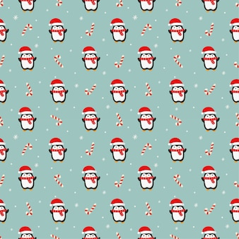 Nahtloses weihnachtsmuster mit pinguin auf blauem hintergrund