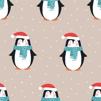Nahtloses weihnachtsmuster mit pinguinen.