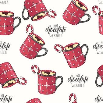 Nahtloses weihnachtsmuster mit schale heißer schokolade mit eibisch und süßigkeit