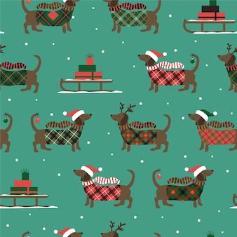 Nahtloses weihnachtsmuster mit schlitten-dackeln und schneeflocken