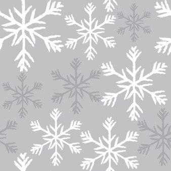 Nahtloses weihnachtsmuster mit silbernem schneeflockendesign