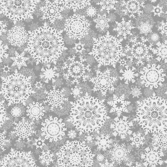 Nahtloses weihnachtsmuster mit stilisierten schneeflocken